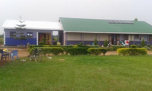 A rainy season sea of grass. Matenity Annex on left.